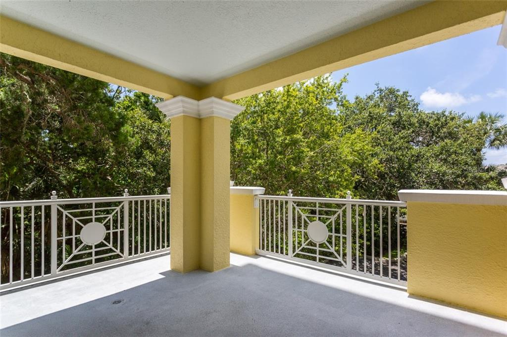 Balcony off dining area for great entertaining - Condo for sale at 1308 Old Stickney Point Rd #W24, Sarasota, FL 34242 - MLS Number is A4471155