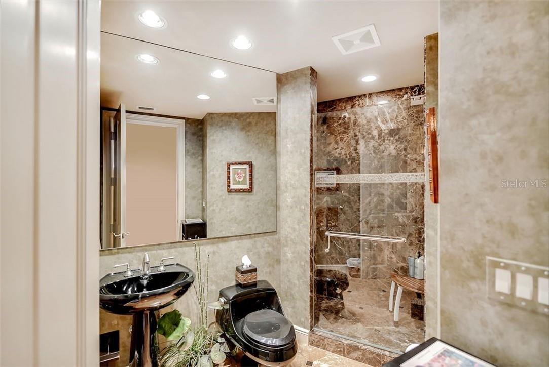 En suite bathroom with tub/shower combination. - Condo for sale at 1300 Benjamin Franklin Dr #708, Sarasota, FL 34236 - MLS Number is A4471978