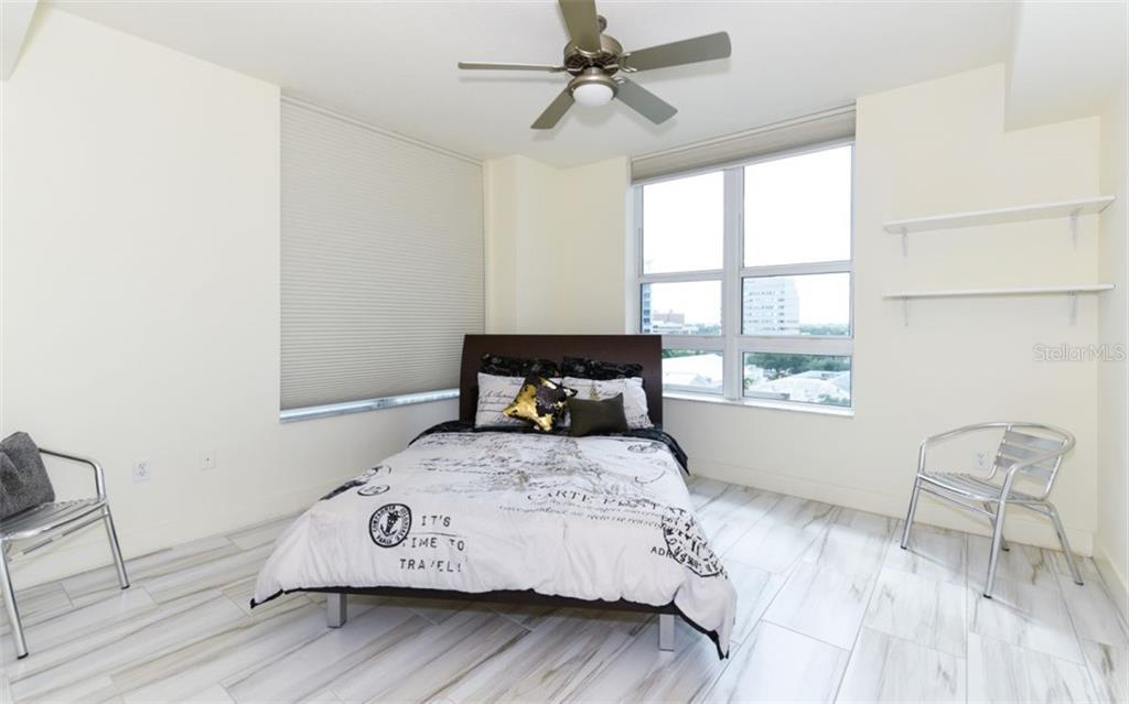 Second bedroom with corner windows providing great natural light - Condo for sale at 1350 Main St #701, Sarasota, FL 34236 - MLS Number is A4472236