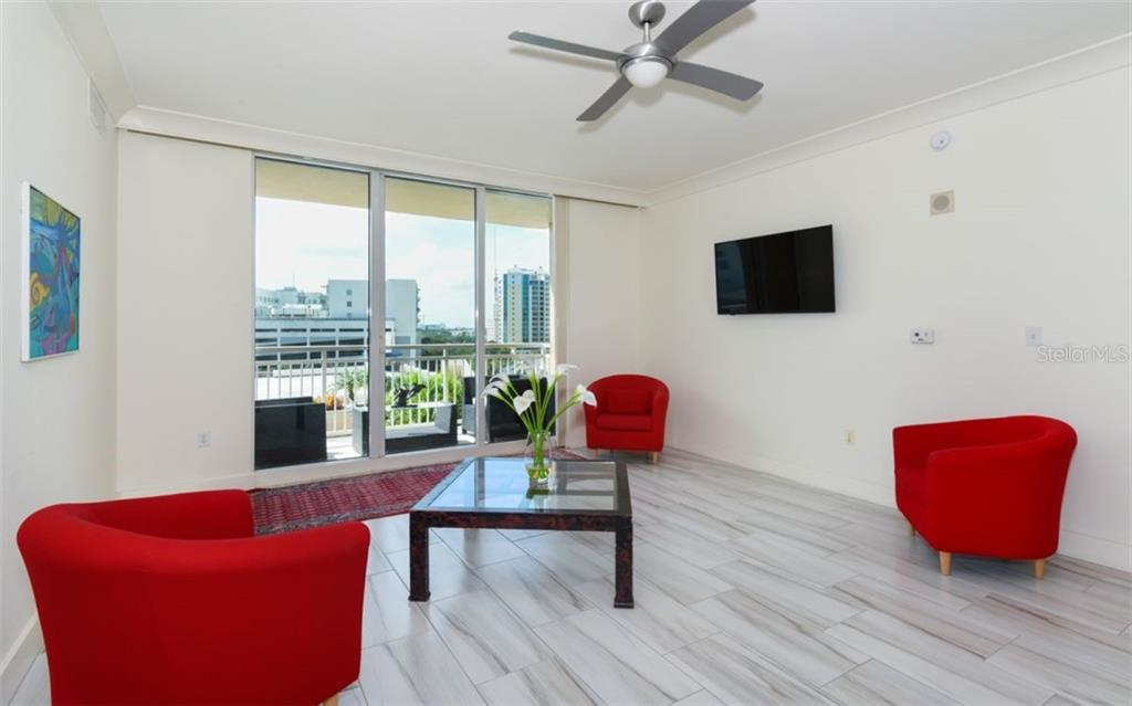 New porcelain tile flooring in the great room - Condo for sale at 1350 Main St #701, Sarasota, FL 34236 - MLS Number is A4472236