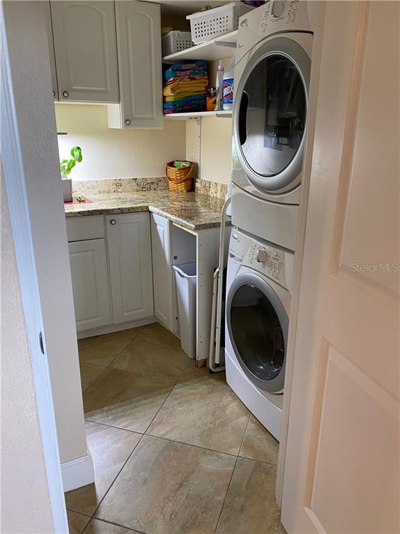 The laundry room offers full size washer & dryer. - Condo for sale at 5770 Midnight Pass Rd #509c, Sarasota, FL 34242 - MLS Number is A4472645