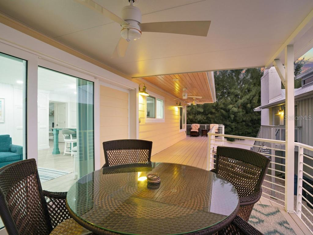 Sunset views on wrap around covered porch area - Single Family Home for sale at 500 Beach Rd #1, Sarasota, FL 34242 - MLS Number is A4474527