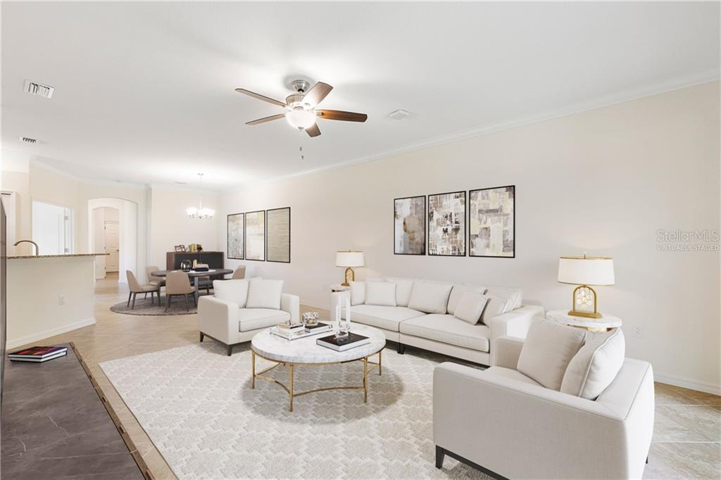 Virtually staged living room and den - Villa for sale at 12627 Garibaldi Ln, Venice, FL 34293 - MLS Number is A4474568