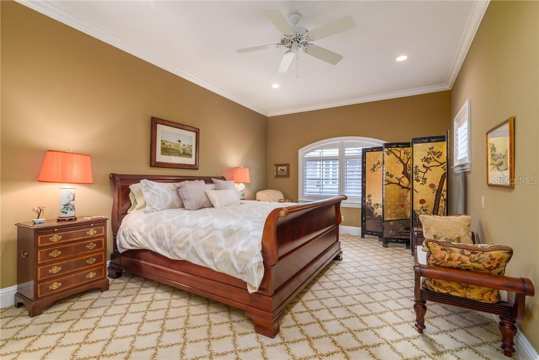 Spacious welcoming Bedroom III upstairs in main house features large walk in closet and a secondary closet plus plantation shutters. - Single Family Home for sale at 1807 Oleander St, Sarasota, FL 34239 - MLS Number is A4475067