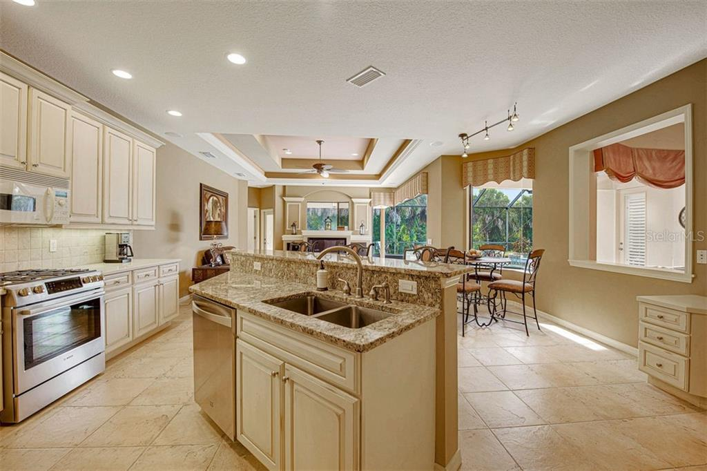 Chefs kitchen, roomy and so functional - Single Family Home for sale at 684 Crane Prairie Way, Osprey, FL 34229 - MLS Number is A4478575