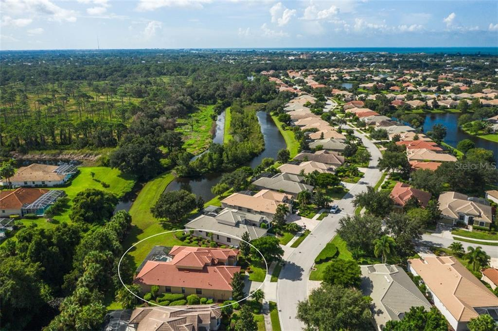 Greenbelt views to Oscar Scherer State Park beyond - Single Family Home for sale at 684 Crane Prairie Way, Osprey, FL 34229 - MLS Number is A4478575