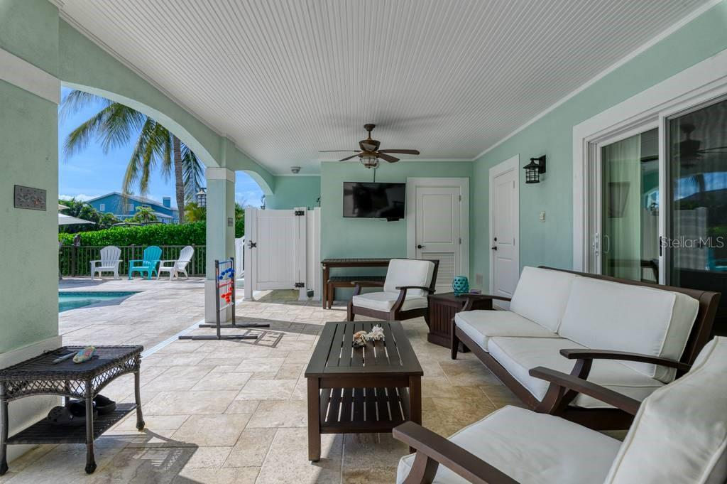 First floor patio with hot/cold shower and pool room. - Single Family Home for sale at 718 Key Royale Dr, Holmes Beach, FL 34217 - MLS Number is A4480381
