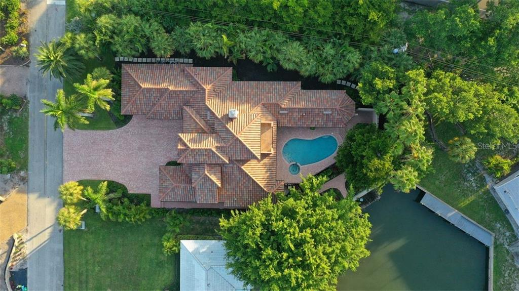 A large lot ensconced with mature trees/ bushes for ultimate privacy while enjoying nature ! - Single Family Home for sale at 501 Cutter Ln, Longboat Key, FL 34228 - MLS Number is A4480484