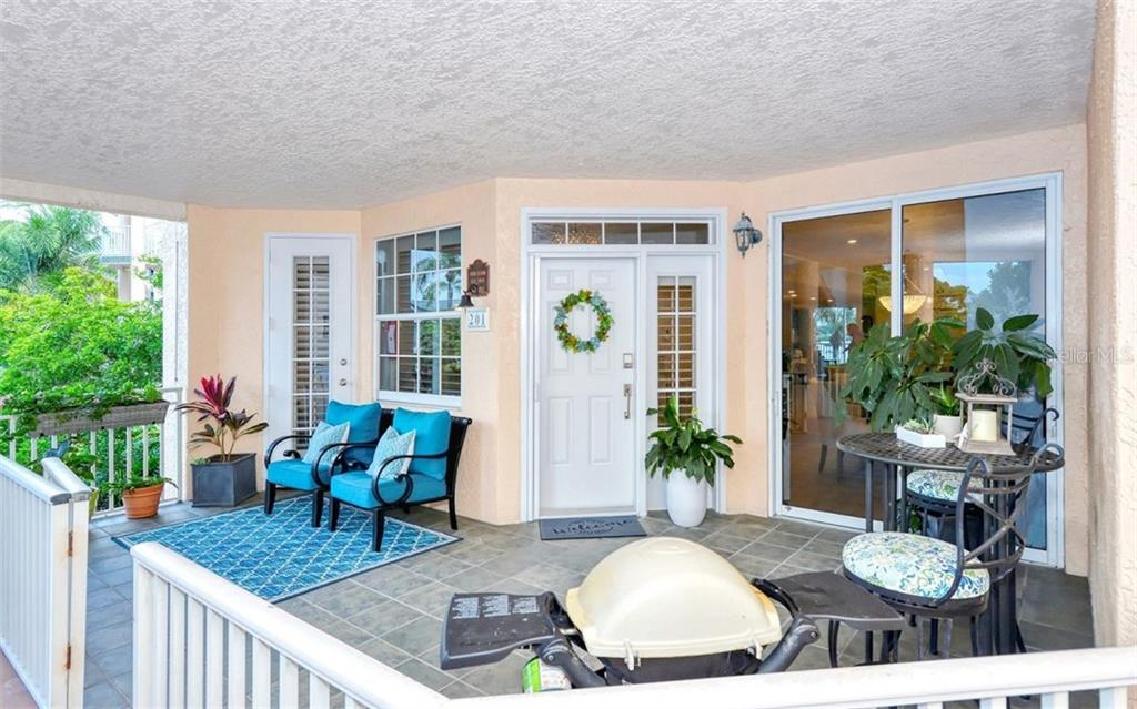 The entry lanai.  One of three lanai's. - Condo for sale at 1240 Dolphin Bay Way #201, Sarasota, FL 34242 - MLS Number is A4480544