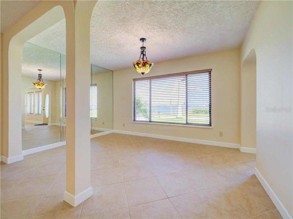 View of open dining room and river view. - Single Family Home for sale at 2408 Riverside Dr E, Bradenton, FL 34208 - MLS Number is A4480609