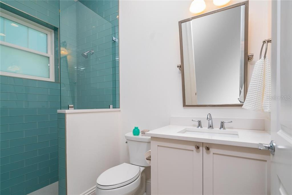 En-suite Bath to Second Bedroom - Single Family Home for sale at 1778 Hyde Park St, Sarasota, FL 34239 - MLS Number is A4480901