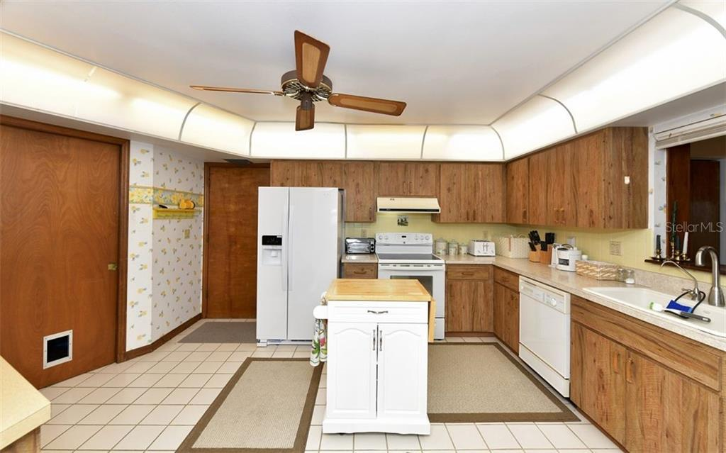 Kitchen-door on very left is pantry and laundry - Single Family Home for sale at 9219 Bimini Dr, Bradenton, FL 34210 - MLS Number is A4483083