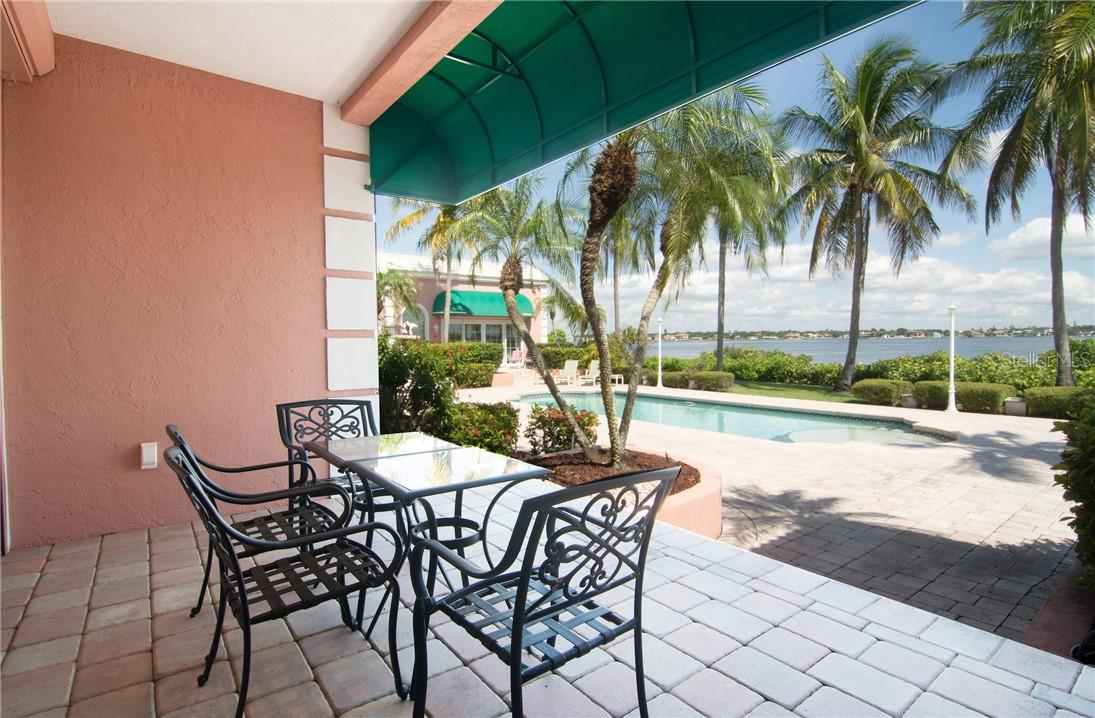 Covered patio outside breakfast room. Beautiful views of pool and intercoastal. - Single Family Home for sale at Address Withheld, Sarasota, FL 34242 - MLS Number is A4483403