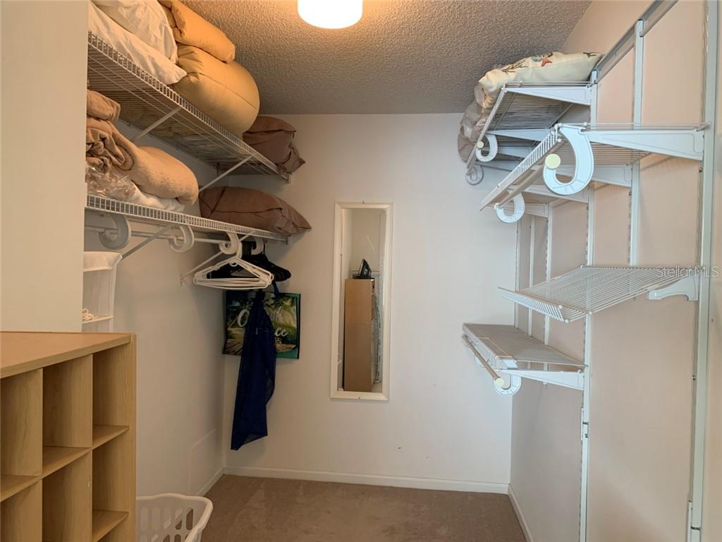 Spacious Walk-in Closet - Condo for sale at 9011 Midnight Pass Rd #328, Sarasota, FL 34242 - MLS Number is A4483601