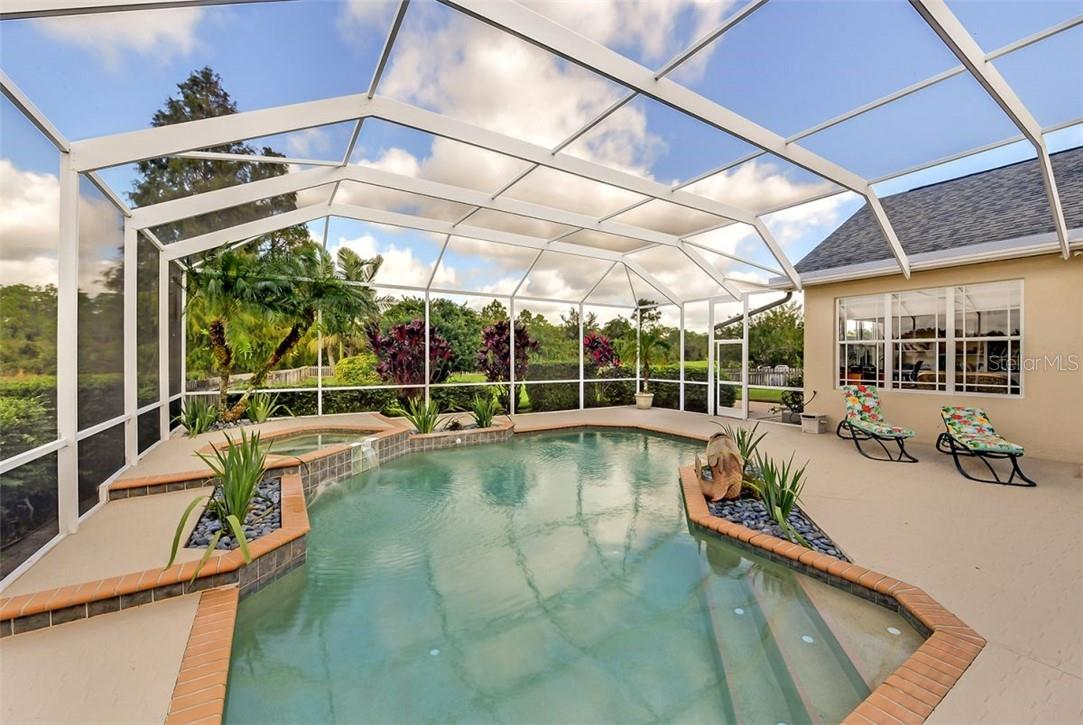 Large heated pool and spa - Single Family Home for sale at 7832 Panther Ridge Trl, Bradenton, FL 34202 - MLS Number is A4483837