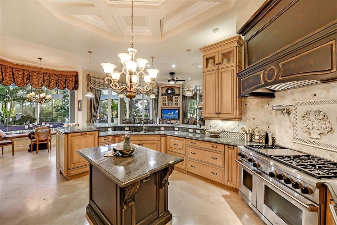 The designer island is like a fine piece of furniture with such detail but very useable - Single Family Home for sale at 8263 Archers Ct, Sarasota, FL 34240 - MLS Number is A4483993