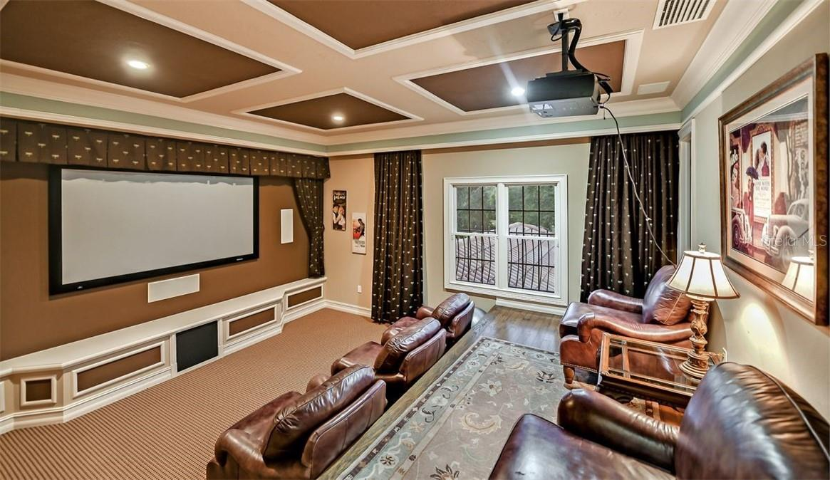 Home Theatre room, with very comfortable club chairs, all new equipment ordered & it's on the way. - Single Family Home for sale at 8263 Archers Ct, Sarasota, FL 34240 - MLS Number is A4483993