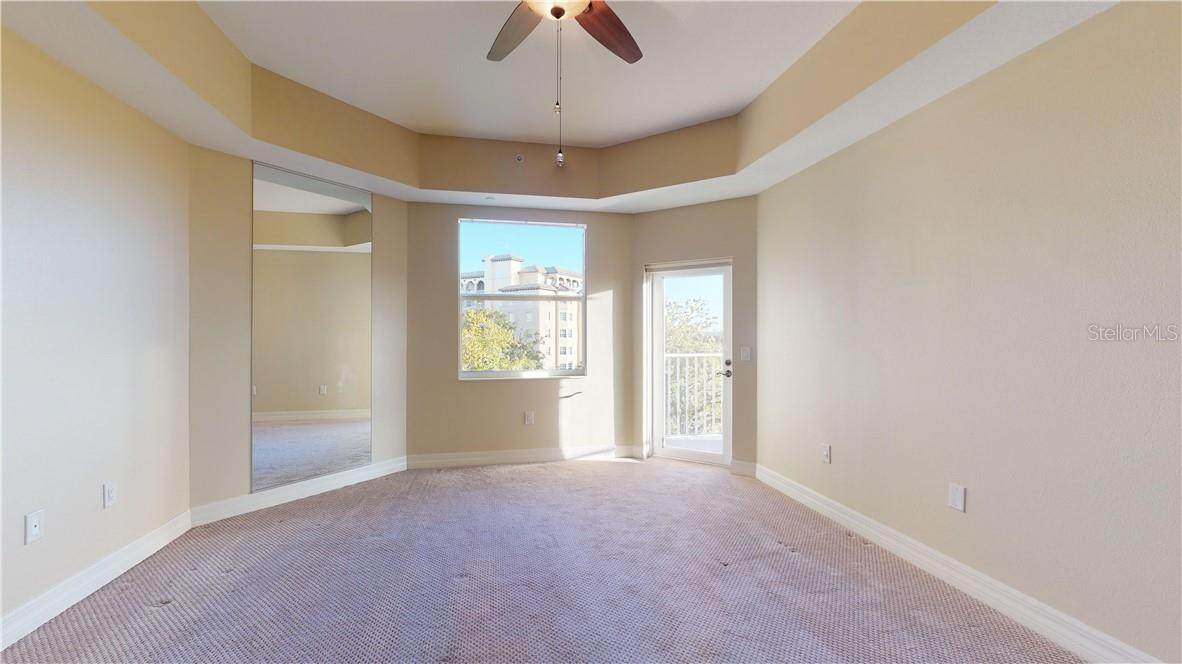 Primary bedroom with access to balcony - Condo for sale at 5591 Cannes Cir #506, Sarasota, FL 34231 - MLS Number is A4484243