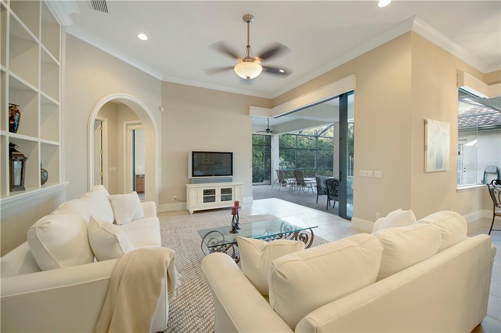 Family room with 90 degree disappearing sliders - Single Family Home for sale at 13223 Palmers Creek Ter, Lakewood Ranch, FL 34202 - MLS Number is A4484826