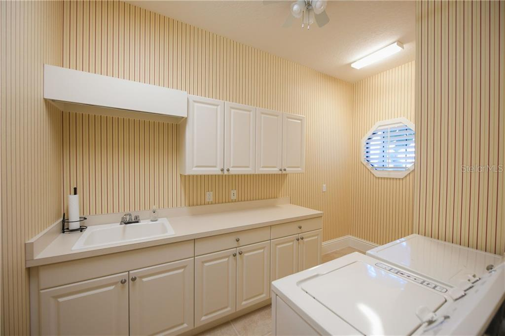 Oversized laundry room with utility sink, ample cabinetry and storage closet - Single Family Home for sale at 13223 Palmers Creek Ter, Lakewood Ranch, FL 34202 - MLS Number is A4484826