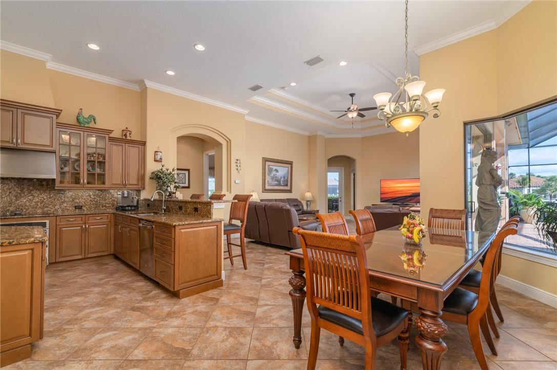 The owners also extended the Breakfast Area to accommodate their large family with an oversized table in the breakfast nook. - Single Family Home for sale at 11720 Rive Isle Run, Parrish, FL 34219 - MLS Number is A4486302