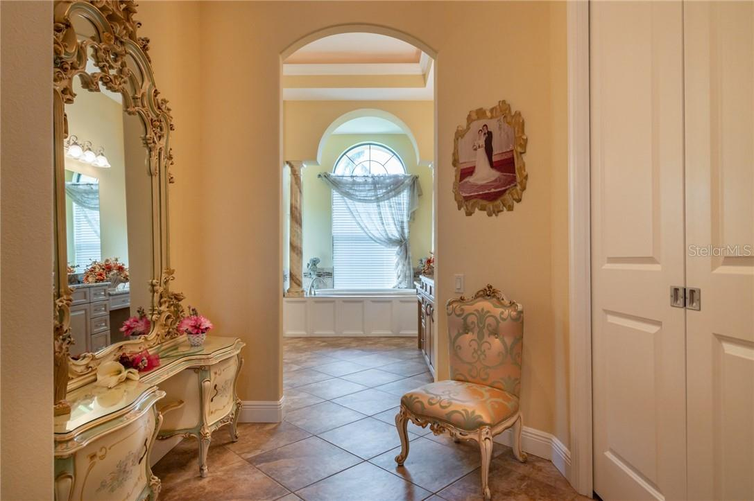 The Dressing Area with easy access to two large, walk-in closets. - Single Family Home for sale at 11720 Rive Isle Run, Parrish, FL 34219 - MLS Number is A4486302