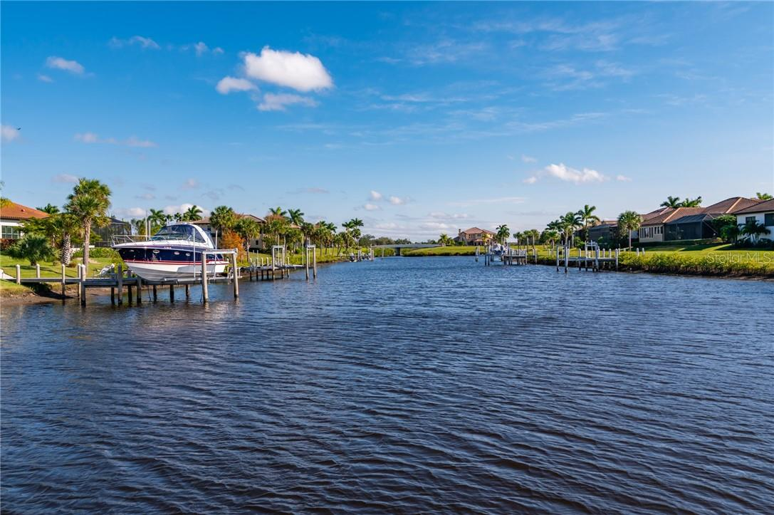 The view of the water from the dock. - Single Family Home for sale at 11720 Rive Isle Run, Parrish, FL 34219 - MLS Number is A4486302