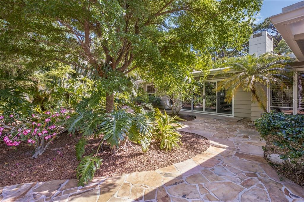 Single Family Home for sale at 7219 Pine Needle Rd, Sarasota, FL 34242 - MLS Number is A4487525