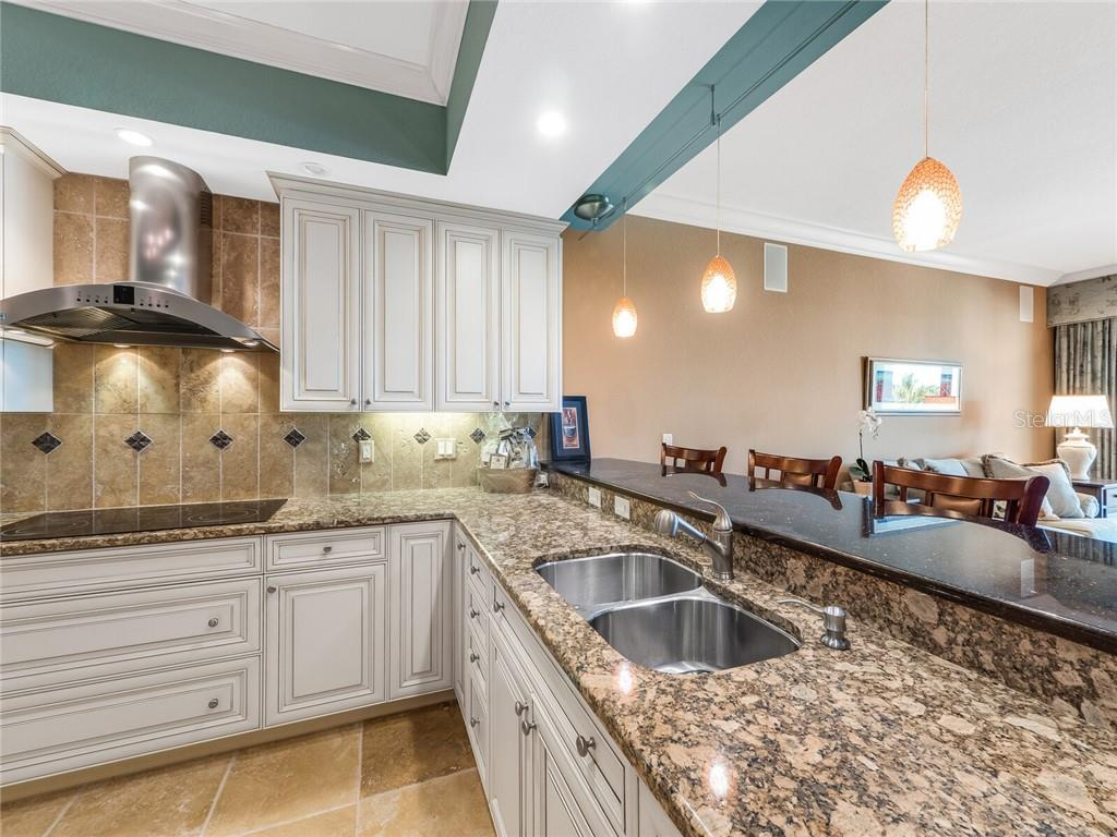 Beautiful interior design making this kitchen easy to use and fun to cook. - Condo for sale at 14021 Bellagio Way #407, Osprey, FL 34229 - MLS Number is A4487552