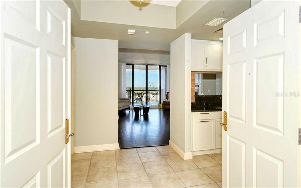 Double doors open to the foyer - Condo for sale at 50 Central Ave #14b, Sarasota, FL 34236 - MLS Number is A4487974
