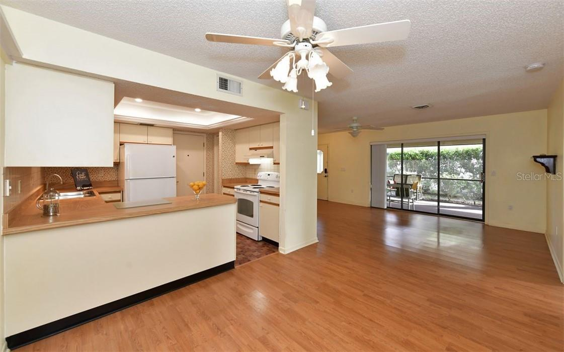 From dining area, looking into kitchen & living room. - Villa for sale at 3314 Vivienda Blvd, Bradenton, FL 34207 - MLS Number is A4488348