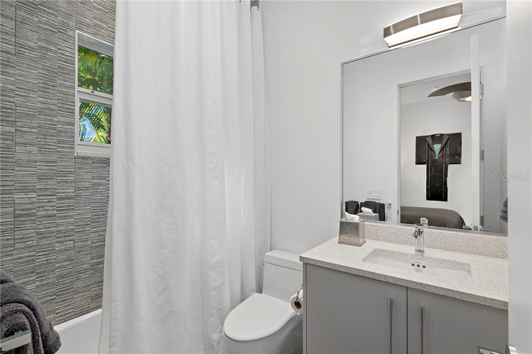Owner's Suite with a private en-suite workstation complete with custom cabinetry and built-in desk - Single Family Home for sale at 2524 Pleasant Pl, Sarasota, FL 34239 - MLS Number is A4490046