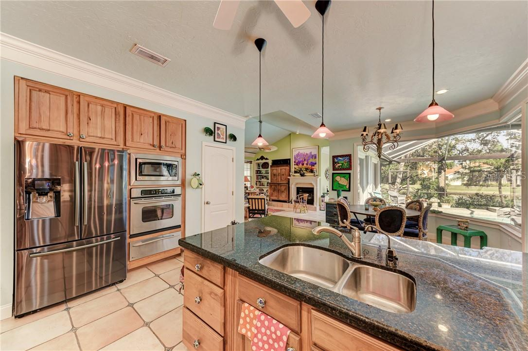 Stainless steel appliances, including French door fridge, warming drawer, and Bosch dishwasher - Single Family Home for sale at 7879 Estancia Way, Sarasota, FL 34238 - MLS Number is A4490318