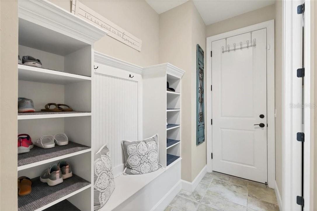 Rearentry mud room area - storage for your backpacks, totes, shoes, boots - no clutter in this home. Storage for everything. - Single Family Home for sale at 11713 Blue Hill Trl, Bradenton, FL 34211 - MLS Number is A4490622