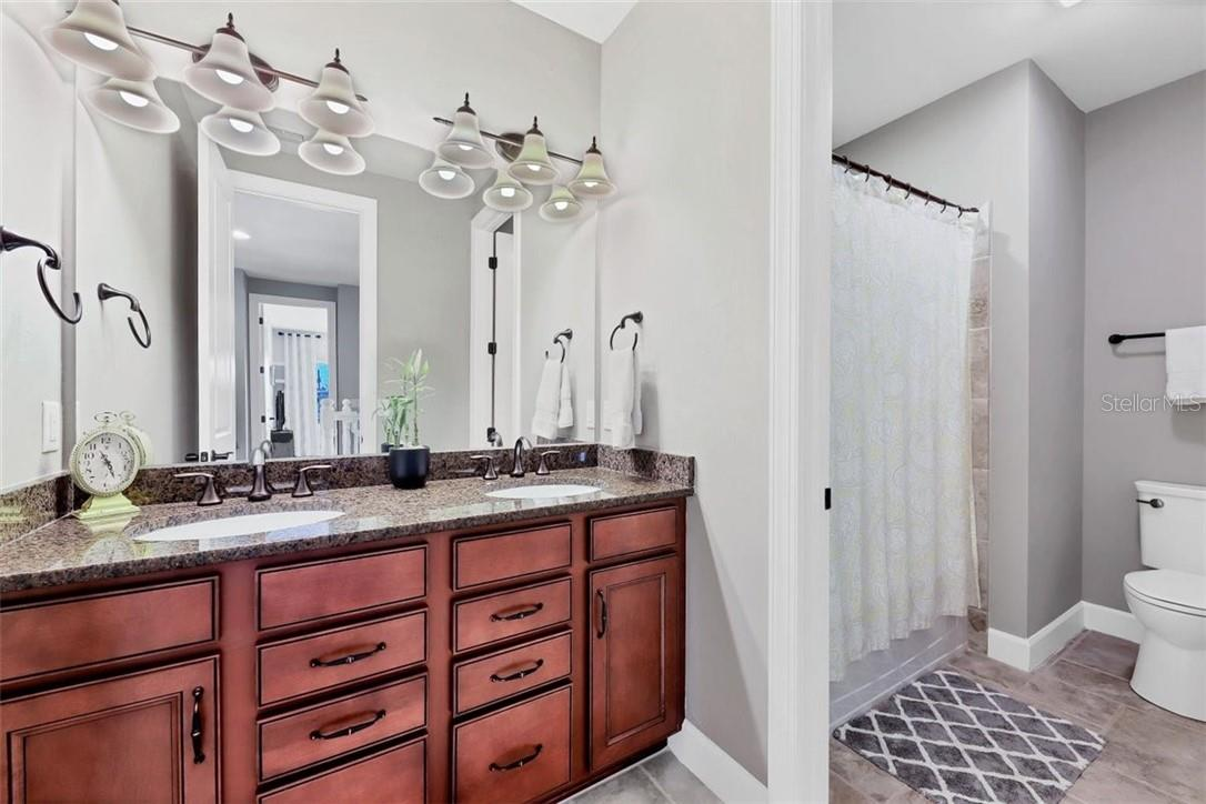 Bathroom #2, separate toilet/shower room from the vanity. - Single Family Home for sale at 11713 Blue Hill Trl, Bradenton, FL 34211 - MLS Number is A4490622