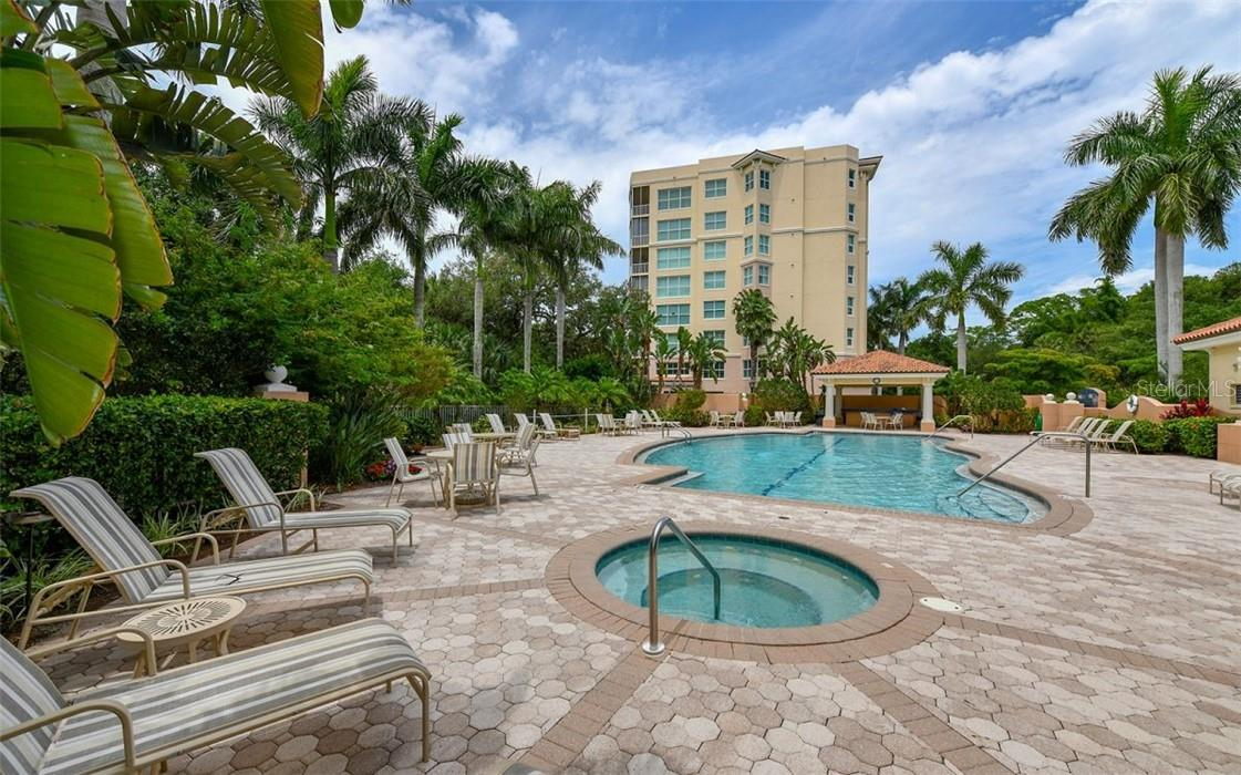 Pool and spa, and a grill and cabana for Meridian - Condo for sale at 409 N Point Rd #402, Osprey, FL 34229 - MLS Number is A4491620