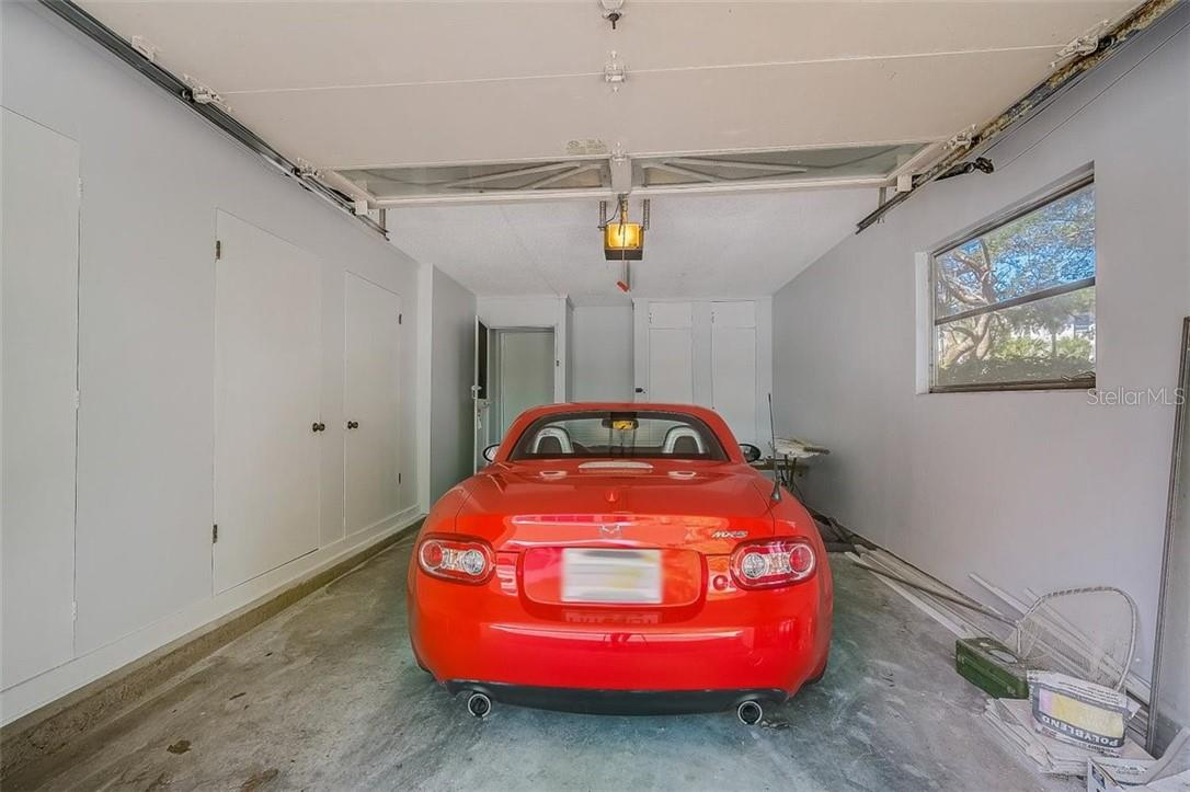 577 Sutton Place Longboat Key Florida 34228 | Spacious 1 Car Garage with Loads of Storage | CAR DOES NOT CONVEY - Condo for sale at 577 Sutton Pl #T-25, Longboat Key, FL 34228 - MLS Number is A4492432