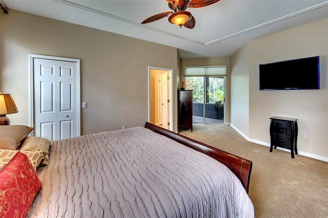 Suite with Walk-In Closet - Single Family Home for sale at 7739 Us Open Loop, Lakewood Ranch, FL 34202 - MLS Number is A4494156