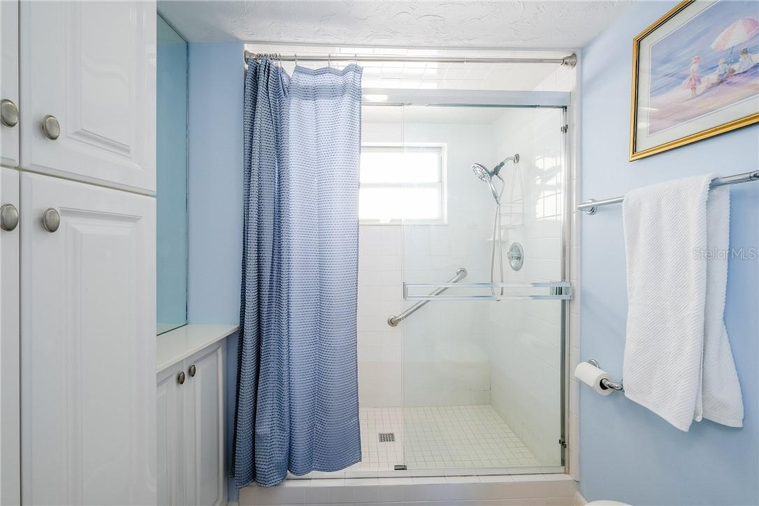 Master Bathroom with Large Walk-In Shower - Condo for sale at 6300 Midnight Pass Rd #701, Sarasota, FL 34242 - MLS Number is A4496847