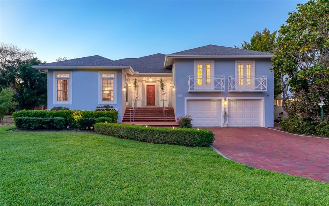 Landscape lighting enhances the front and back of this property. - Single Family Home for sale at 437 Cleveland Dr, Sarasota, FL 34236 - MLS Number is A4497923