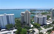 Aerial view of building and Sarasota Bay out to Bird, Lido and Longboat Keys - Condo for sale at 500 S Palm Ave #41, Sarasota, FL 34236 - MLS Number is A4144835