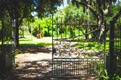 Original wrought iron gated-entry dating back to the 1890s. - Vacant Land for sale at 50 W Bay St, Osprey, FL 34229 - MLS Number is A4158305