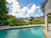 Swimming pool and open deck with water views - Single Family Home for sale at 1272 Riegels Landing Dr, Sarasota, FL 34242 - MLS Number is A4160033