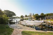Dock with lift - Single Family Home for sale at 827 Paradise Way, Sarasota, FL 34242 - MLS Number is A4167744
