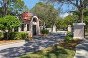 Community entrance guard house - Condo for sale at 7631 Fairway Woods Dr #601, Sarasota, FL 34238 - MLS Number is A4168292