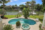 Boat Lift and Dock Space for not just one, but TWO Boats!! - Single Family Home for sale at 722 Siesta Dr, Sarasota, FL 34242 - MLS Number is A4169257