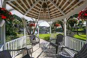 Private and relaxing gazebo with water views. - Single Family Home for sale at 5281 Cape Leyte Way, Sarasota, FL 34242 - MLS Number is A4171478