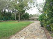 Side Yard - Single Family Home for sale at 16314 Golf Course Rd, Parrish, FL 34219 - MLS Number is A4171555