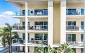 Sunny lanai with outdoor kitchen faces courtyard pool and has a peek-a-boo view of the Gulf! - Condo for sale at 6512 Midnight Pass Rd #406, Sarasota, FL 34242 - MLS Number is A4171720