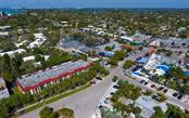 Aerial view of building and heart of Siesta Key Village - Condo for sale at 133 Avenida Messina #4, Sarasota, FL 34242 - MLS Number is A4179566